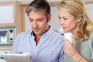 Couple looking at our website on an iPad